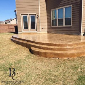 Concrete patio with built-in steps - Bankston Concrete in San Antonio, TX